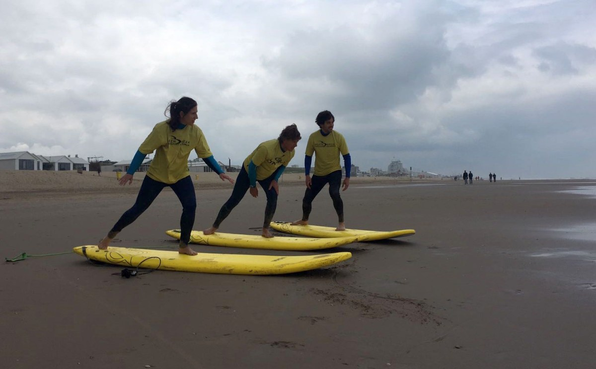 TheSocialMedwork team learning to surf